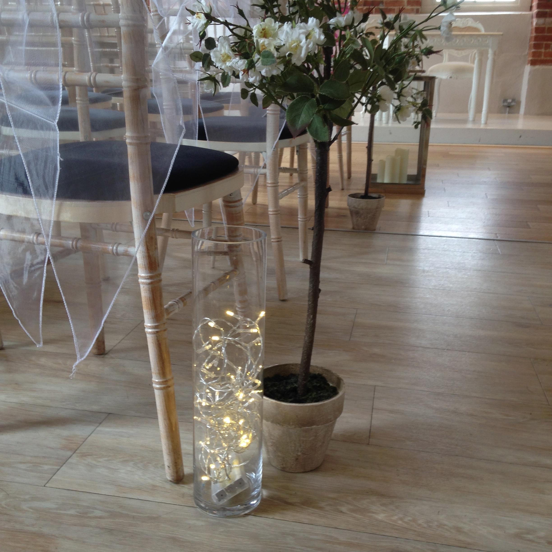 Tall cylinder vases incabella wedding hire